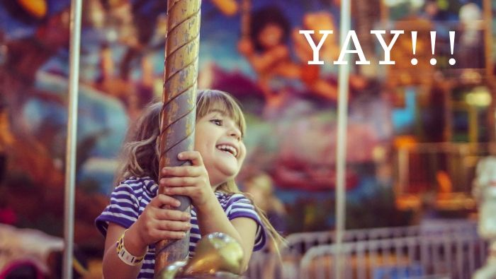 Joy of a child on a merry go round big announcement